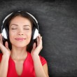 Music in headphones - Beautiful woman listening — Stock Photo #40836207