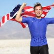 Success - winning runner cheering with USA flag — Stock Photo