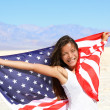 Beautiful woman with the American flag — Stock Photo #40836239