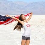 USA flag - woman athlete showing american flag — Stock Photo
