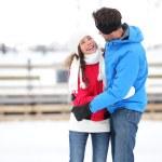 Ice skating romantic couple on date iceskating — Stock Photo