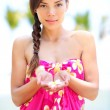 Beautiful serene woman on beach in sarong — Stockfoto