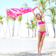 Beach woman waving scarf on happy free vacation — Stock Photo