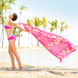 Woman happy enjoying beach - scarf blowing in wind — Stock Photo #40836337