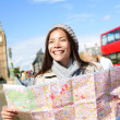 London tourist woman sightseeing holding map — Stock Photo