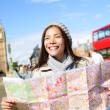 London tourist woman sightseeing holding map — Stock Photo