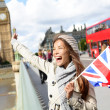 London - happy tourist holding UK flag by Big Ben — Stock Photo