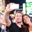 Dating couple happy in love taking selfie photo on Times Square — Stock Photo #40836529