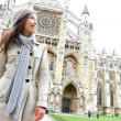 Stock Photo: Westminster Abbey church London with young woman