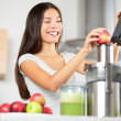 Juicing - woman making apple and vegetable juice — Stock Photo #40836591