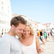 Traveling couple using tablet computer in Venice — Stock Photo