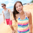 Beach people - young couple holding hands walking — Stock Photo #40836931