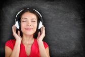 Music in headphones - Beautiful woman listening — Stock Photo