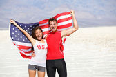 USA athletes people holding american flag cheering — Stock Photo