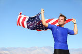 Athlete young man with the American flag — Stock Photo