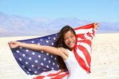 Beautiful woman with the American flag — Stock Photo