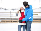 Ice skating romantic couple on date iceskating — Stock Photo