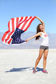 US flag - woman athlete showing american flag USA — Stock Photo