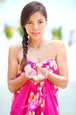 Beautiful serene woman on beach in sarong — Stock Photo