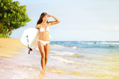 Surfboard woman walking in beach water — Stock Photo
