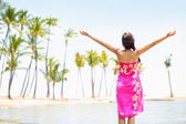 Praising happy freedom woman on beach in sarong — Stock Photo