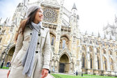Westminster Abbey church London with young woman — Stock Photo