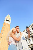 Couple taking selfie picture on travel in Venice — Stock Photo