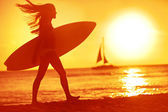 Surfing surfer woman babe beach fun at sunset — Stock Photo