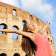 Stock Photo: Happy carefree elated travel womby Colosseum