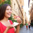 Pizza woman eating pizza slice in Rome, Italy — Stockfoto