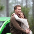 Couple driving in green car in love on travel — Stock Photo