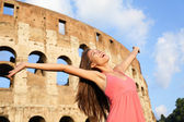 Happy carefree elated travel woman by Colosseum — Stock Photo