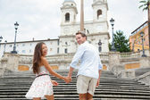Couple holding hands on Spanish Steps, Rome, Italy — Stock Photo
