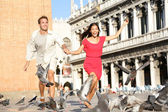 Couple in love having playful fun in Venice — Stock Photo