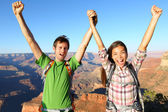 Happy people celebrating cheering in Grand Canyon — Stock Photo