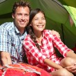 Couple camping in tent happy in romance — Zdjęcie stockowe