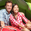 Couple camping in tent happy in romance — Stok fotoğraf