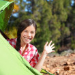 Camping woman waving hello from tent — Stock Photo #41997323