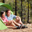 Stock Photo: Camping couple in tent sitting looking at view
