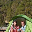 Camping people - couple eating in tent happy — Stock Photo