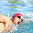 Swimmer man swimming crawl in blue water — Stock Photo #41997359