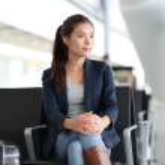 Airport woman waiting in terminal - air travel — Stock Photo #41997465