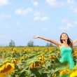 Happy carefree summer girl in sunflower field — Stock Photo
