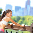 Running woman stretching after jogging in New York — Stock Photo