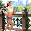 Running woman jogging to music in New York City — Stock Photo