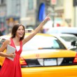 Girl calling taxi cab in New York City — Stock Photo