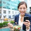 Business woman eating salad on lunch break — Stock Photo