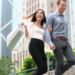 Stock Photo: Couple shopping walking happy in Hong Kong