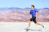 Man running outdoor sprinting for success — Stock Photo