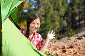Camping woman waving hello from tent — Stock Photo